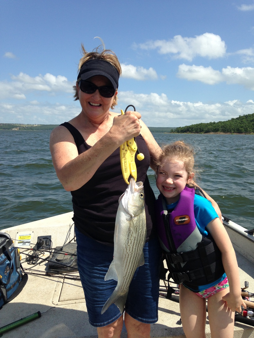 Skiatook lake fishing for hybrid stripers w family 6 21 15 for Grand lake ok fishing report