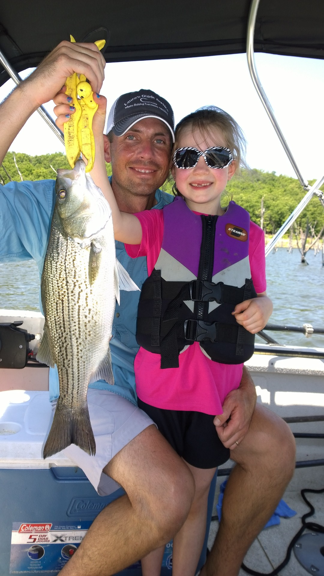 Skiatook lake with family fishing for hybrid striper 6 10 15 for Fishing for stripers